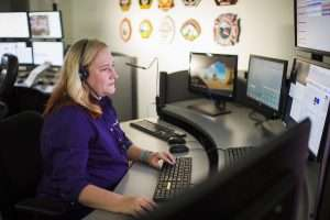 woman at work station using computer aided dispatch