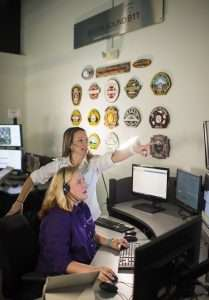 two women working together on computer aided dispatch