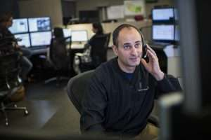 Man with headset on working dispatch