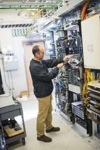 man working on switchboard